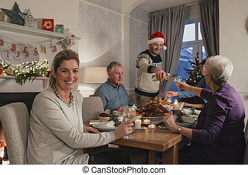 Happy Mother At Christmas Dinner