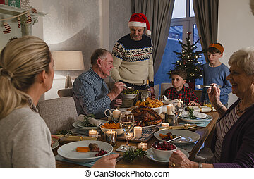 Three Generation Family Christmas Dinner - Three generation...