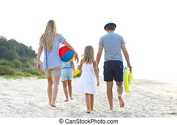 Young family having fun running on beach at sunset. - Happy...