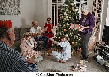 Opening Presents On Christmas Morning - Three generation...