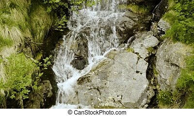 A waterfall in the Swiss mountains. Canton of Tessin. - A...