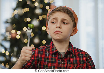 But I Don't Like Brussel Sprouts! - Little boy is holding a...