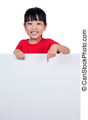 Asian Chinese little girl behind a blank white board in...