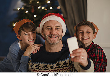Christmas Family Selfie - Father is taking a selfie on his...