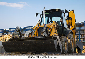 Excavator with a backhoe on the construction area