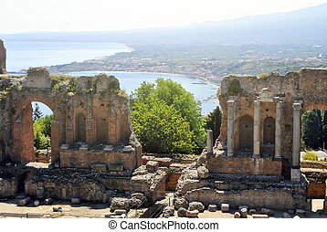 the Ancient Theatre of Taormina with Etna Mountain and...