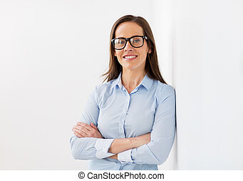 happy smiling middle aged woman in glasses