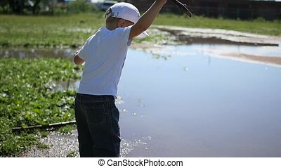 a child playing near the pond. games outdoors