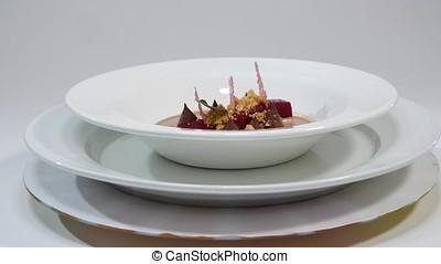 Salad of baked beets, arugula, cheese and nuts. Fresh salad...