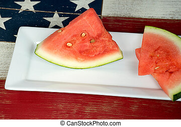 watermelon wedges on plate - ripe watermelon wedges on white...