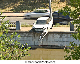 Odd crash -2  - Car rammed the embankment fence.