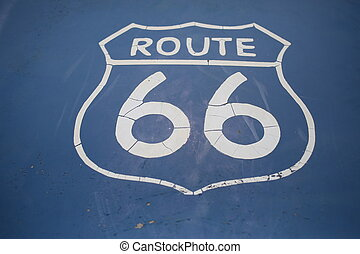 Route 66 sign on blue background. Close up - Graffity sign,...