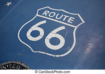Route 66 sign. Close up - Graffity sign, blue background,...