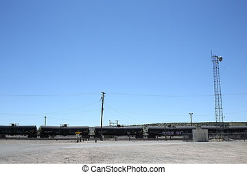 Train with fuel, dangerous cargo, tons of fuel, blue sky,...