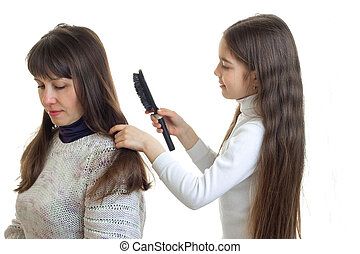 little girl makes her mom hairstyle isolated on white...