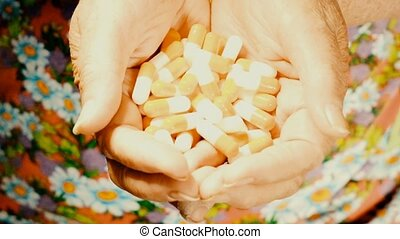 Senior woman with palms full of huge size pills. Vintage...