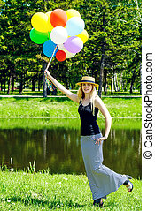 elegant lady with balloons - Happy summer day. Pretty...