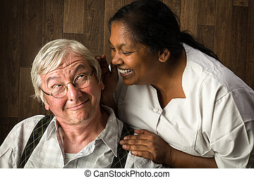 Nurse talking to elderly man - Nurse in a home talking...