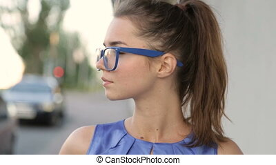 Portrait of a girl wearing glasses