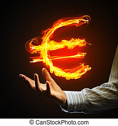 Euro currency fire symbol - Close of businessman hand...