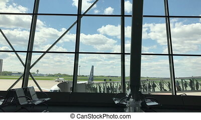 Boarding an Airplane at the Airport. - Boarding an airplane...