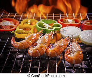 shrimp,prawns grilled on barbecue fire stove with chilly onion for seafood meal
