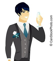 Young asian groom holding glass of champagne. - Asian happy...