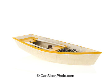 Wooden row boat isolated over white - Wooden yellow row boat...