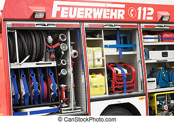 Fire brigade - fire service vehicle with tool and water hose