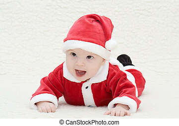 laughing baby in santa's suit