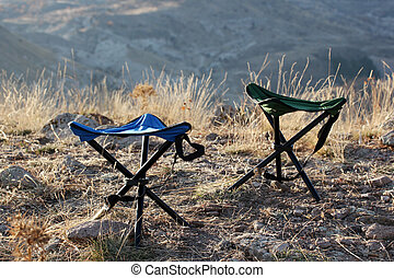 Camping chairs in the nature