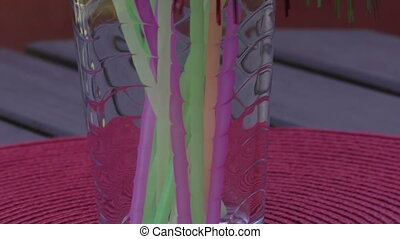 Colorful drinking straws inside a jar