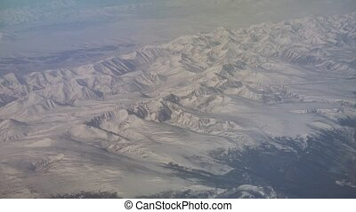 Mongolia aerial view of mountains covered with snow in the...