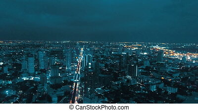 Modern city during beautiful cloudy night - Aerial drone...