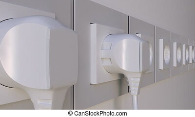 Multiple plugs being inserted into the outlets. Elecric...