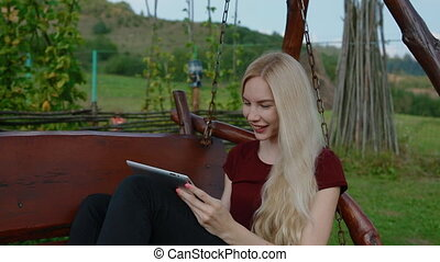 Young woman talk on skype via tablet - Young woman talk on...