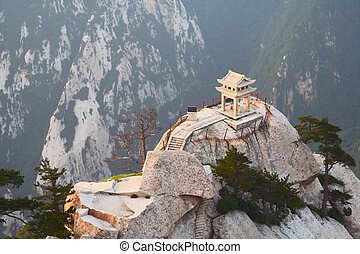 stone pagoda on the East Peak of the holy mountain Huashan,...