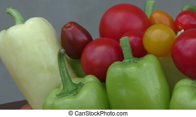 Cherry tomatoes and peppers in bowl. Fresh seasonal...