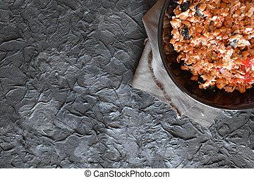 Lentil salad dish put on dark stone table