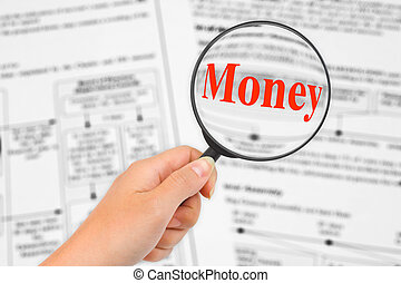 Magnifying glass in hand and word Money