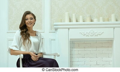 Young beautiful businesswoman in white clothes.Describes his...