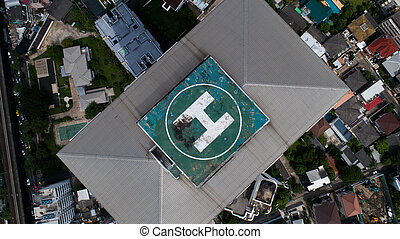 Helipad on top of the skyscraper - Aerial drone top view of...