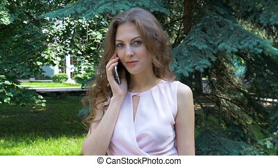 Young sexy woman talking on the phone - A beautiful woman is...