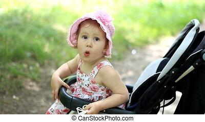 caucasian Child, kid toddler , little baby girl smiling in stroller and