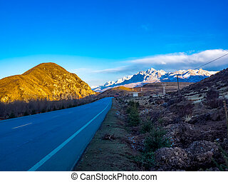View of snow mountain at highway in Sichuan