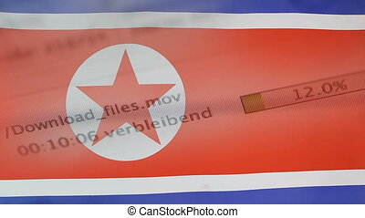 Downloading files on a computer, North Korea flag -...