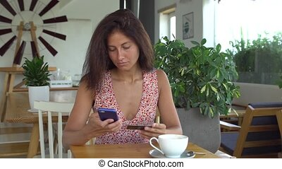 Woman use online banking on smartphone