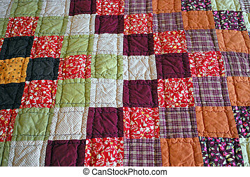 Homemade quilt. - Homemade quilt on a bed.