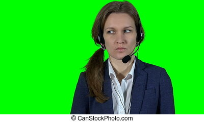 Frustrated online consultant woman with headset on green...