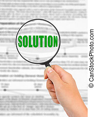 Magnifying glass in hand and word Solution, business...